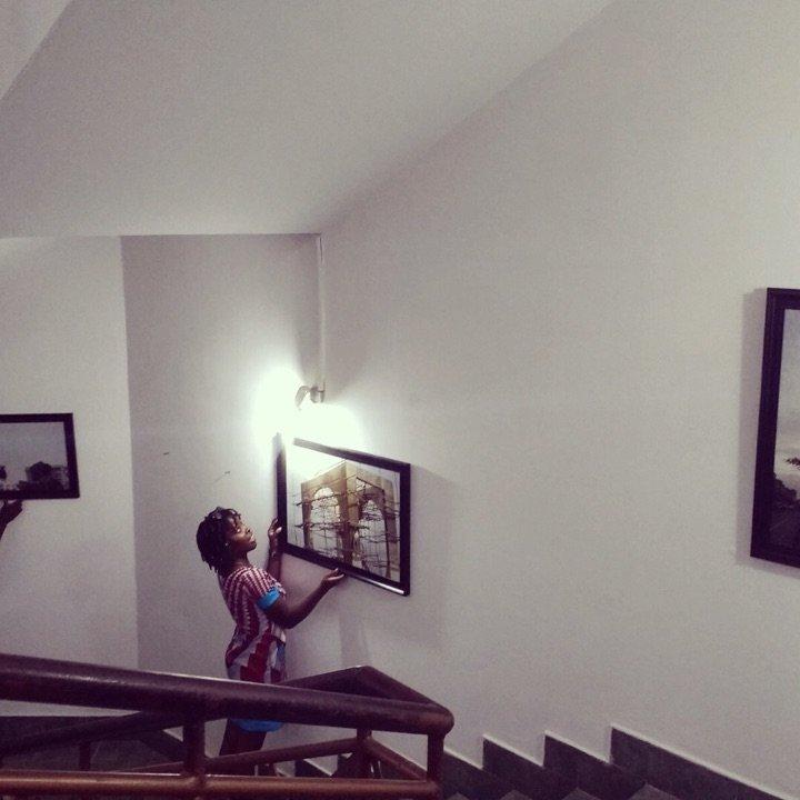 "Curator Kehinde ""Kennii"" Ekundayo, installation of ""Lagos Budding 50"" of documentary photographer Helen Gebregiorgis, at the Revolving Art Incubator, Lagos, Nigeria, December 2017"