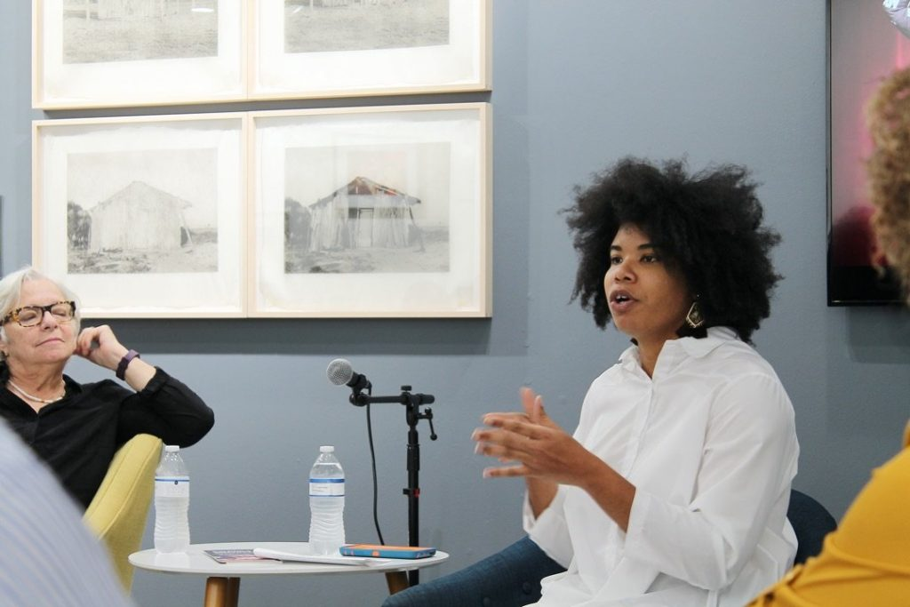Aldeide Delagdo in conversation with artists during Building a Feminist Archive Cuban Women Photographers, 2019 Photo by Diana Larrea