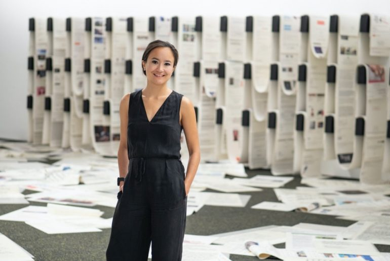 Melanie Pocock in front of 'Office of Unreplied Emails' (2016 – 17) by Camille Henrot, ICA Singapore, 2019. Photography Ken Cheong