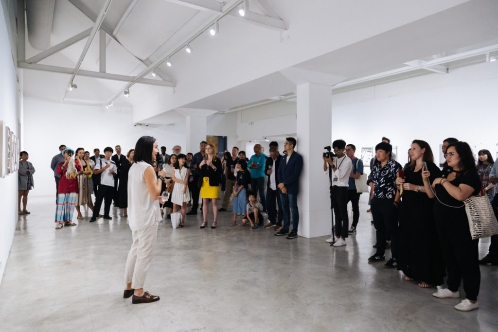 Melanie Pocock talking at the opening of 'Twofold' by Genevieve Chua at STPI – Creative Workshop & Gallery in Singapore, 2019 Photo courtesy STPI