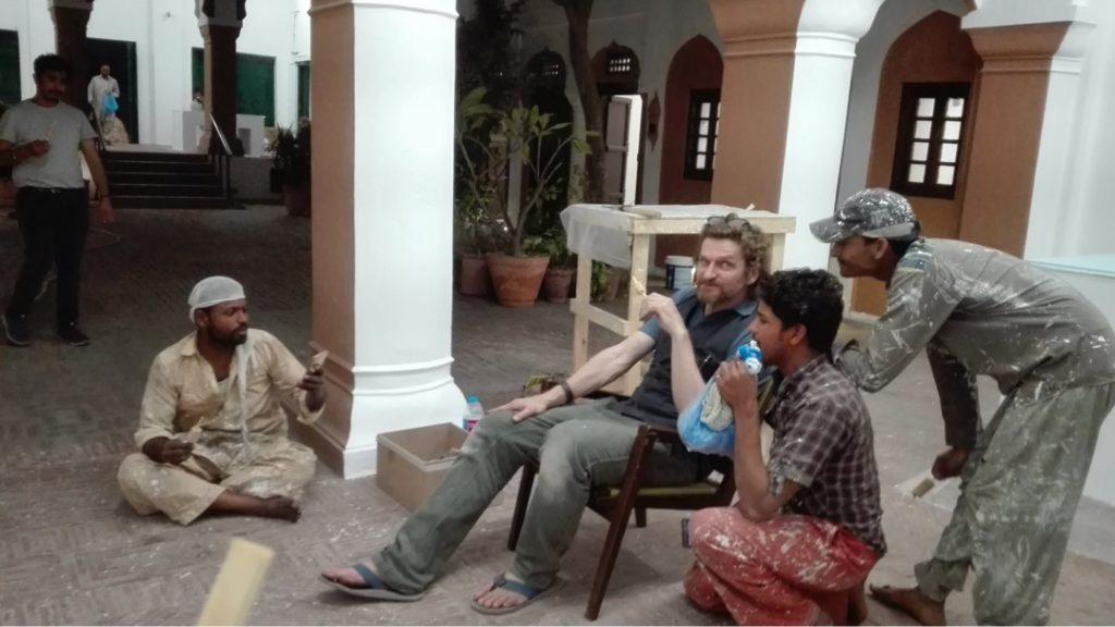 Setting up at Mubarak Haveli for the Lahore Biennale, artist Daniel Hunziker with team eating kulfi. 2018